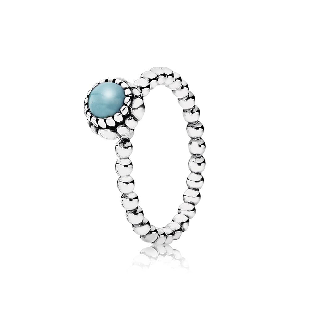 טבעת כסף עם ניצן במרכזה טורקיז